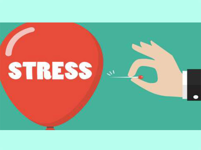 Stress balloon being popped with pin