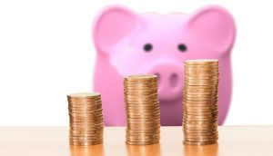 piggy bank looking at coins