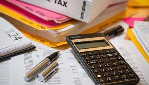 calculator, pen, and books