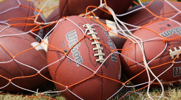 Footballs in net